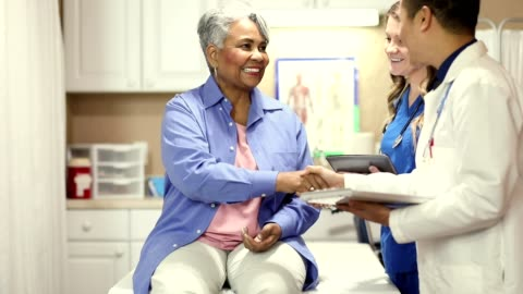 doctor, nurse and senior adult patient in office, clinic. - patient stock videos & royalty-free footage