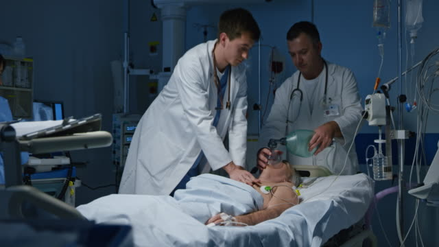 ds doctor performing a cpr on a patient in the intensive care - oxygen mask stock videos and b-roll footage