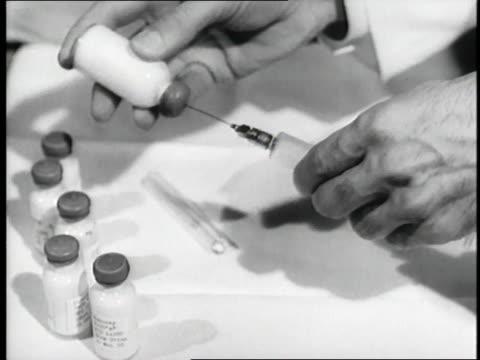 doctor prepares a dosage of jonas salk's polio vaccine. - polio stock videos & royalty-free footage