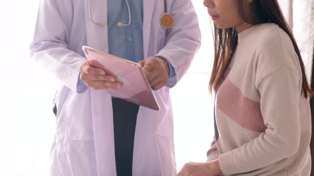 doctor prescribing prescription medicine to patient - voip stock videos & royalty-free footage