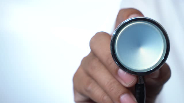doctor reaching stethoscope towards - panning stock videos & royalty-free footage