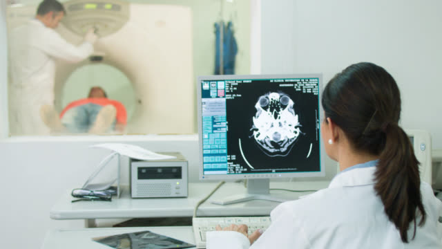 doctor reading a cat scan - medical procedure stock videos and b-roll footage