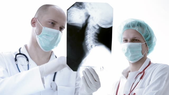 doctor reviews x-ray - protective mask workwear stock videos and b-roll footage