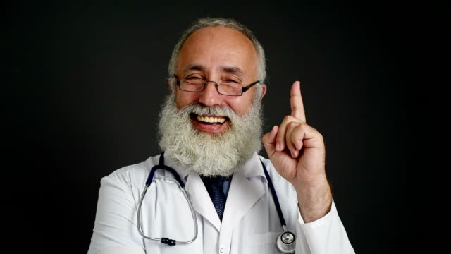 doctor smiling happily finding a solution on a dark background. - shirt and tie stock videos & royalty-free footage