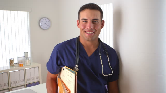 doctor smiling in medical office - waist up stock videos & royalty-free footage