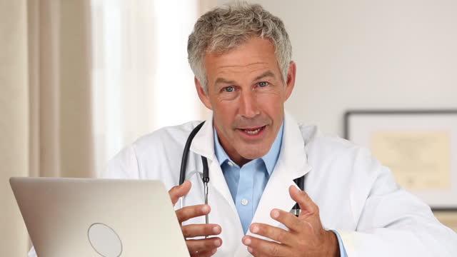 pov doctor talking into camera - quarantenne video stock e b–roll