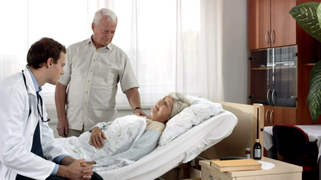 hd dolly: doctor talking to a patient - visit stock videos & royalty-free footage