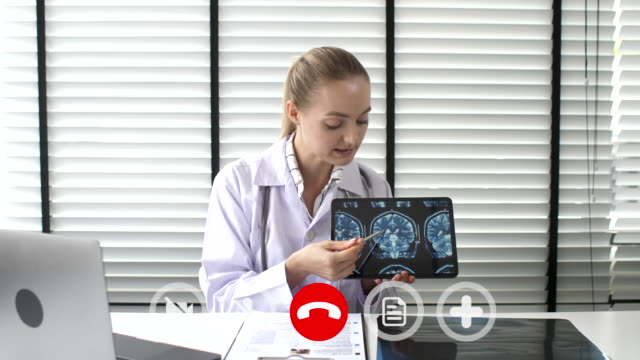 doctor talking to patient by video chat consult online - remote control stock videos & royalty-free footage