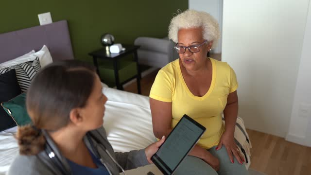 doctor talking to patient during home visit - social services stock videos & royalty-free footage