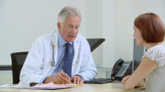 doctor talking to patient - listening stock videos & royalty-free footage