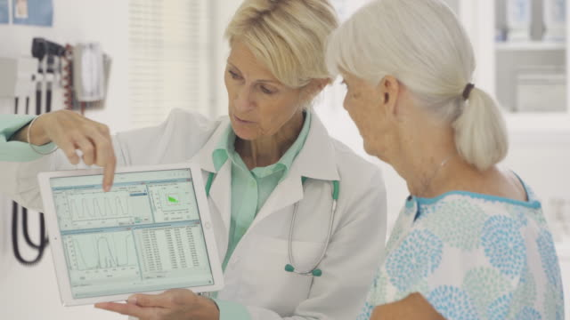 Doctor Talking to Senior Patient About Medical Record
