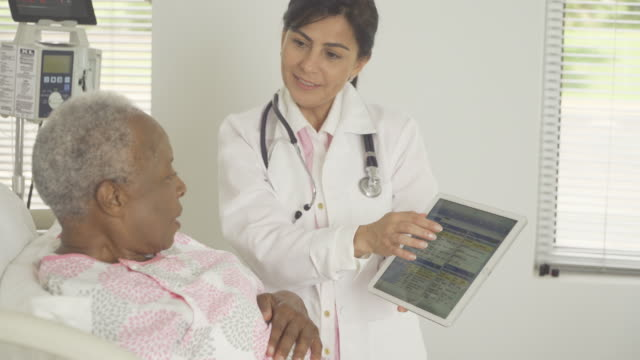 Doctor Talking to Senior Patient in Hospital