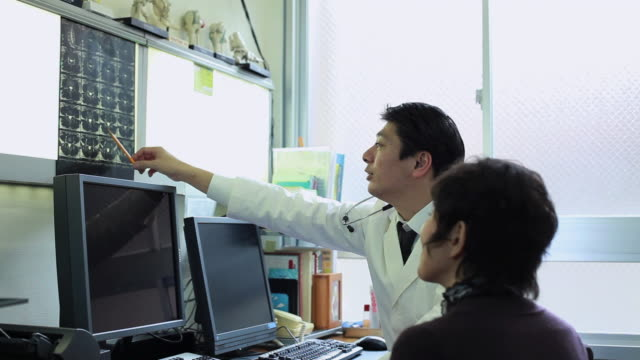 ms doctor talking with patient / shibuya, tokyo, japan     - medical procedure stock videos and b-roll footage