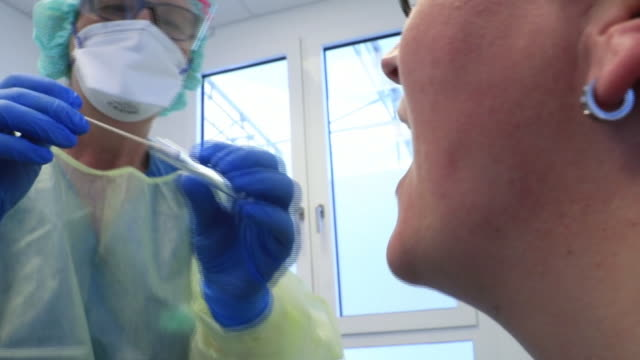 a doctor tests a patient for coronavirus at the paracelsus clinic in zwickau germany on thursday april 2 2020 - germany stock videos & royalty-free footage