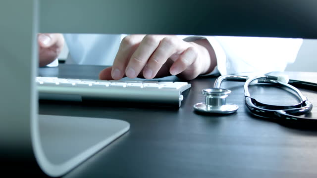doctor type keyboard with stethoscope - medical examination stock videos & royalty-free footage