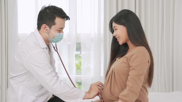 doctor used a stethoscope to check the heart waves for pregnant women who received treatment and prenatal care. - prenatal care stock videos & royalty-free footage