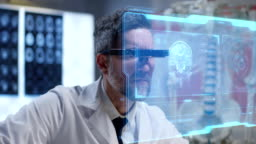 Doctor using holographic display for research