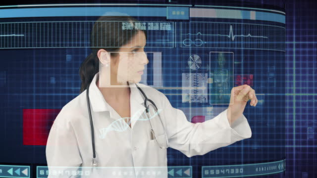doctor using holographic medical interface - hologram stock videos & royalty-free footage