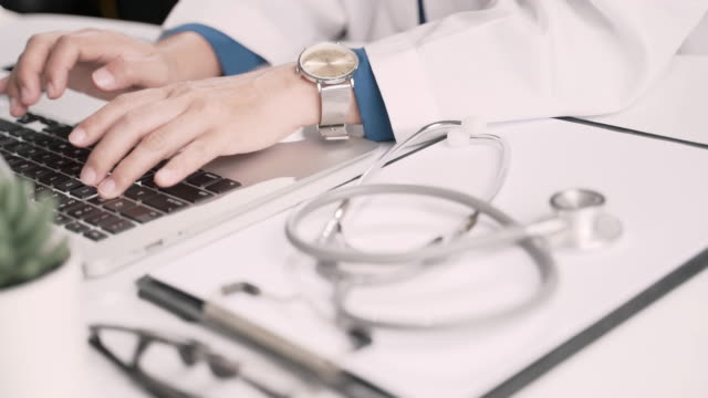 doctor using laptop - typing stock videos & royalty-free footage