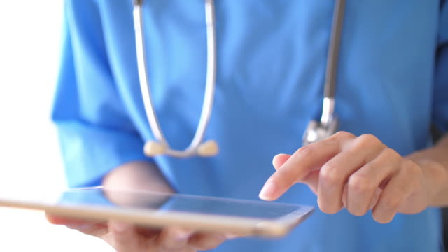 doctor using tablet analyzing digital x-ray film in digital tablet - radiographer stock videos & royalty-free footage
