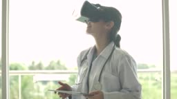 Doctor using Virtual reality headset for healthcare practitioner
