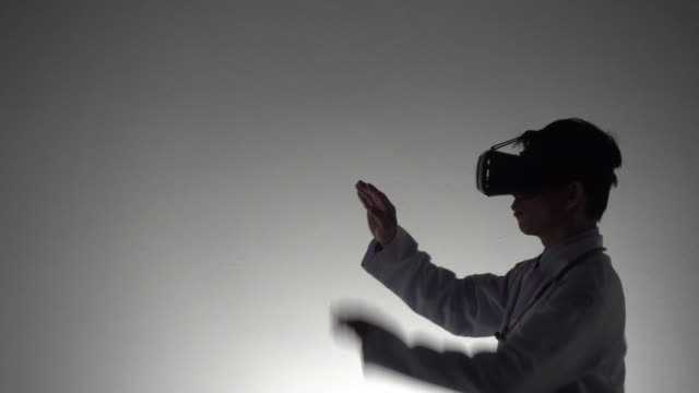doctor using virtual reality headset - examination gown stock videos & royalty-free footage