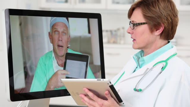 ms pan doctor video conferencing with other doctors and using tablet computer / richmond, virginia, usa - stethoscope stock videos & royalty-free footage