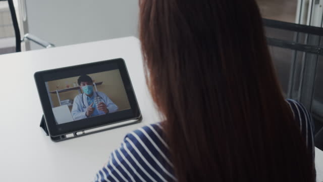 doctor videocall to patient. - south east asia stock videos & royalty-free footage
