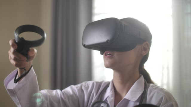 doctor virtual reality headset for healthcare - cyberspace stock videos & royalty-free footage