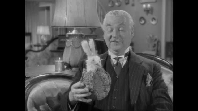 1946 Doctor Watson (Nigel Bruce) inspects rabbit shaped music box
