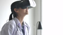 Doctor wearing virtual reality glasses during simulated medical examination with Digital tablet
