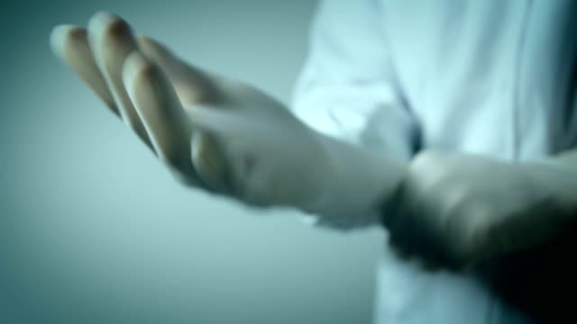 doctor wearing with medical gloves - latex glove stock videos & royalty-free footage