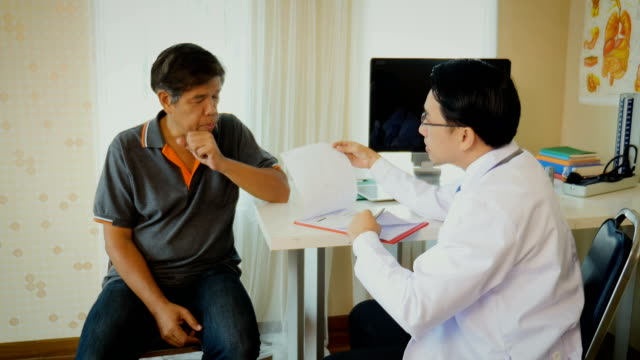 Doctor with senior patient having consultation and medical examination at clinic, healthcare and medical concept