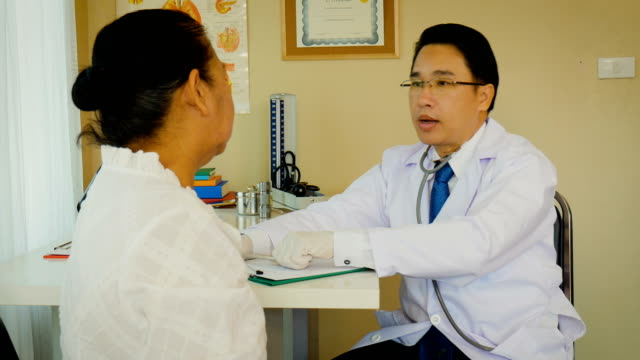 Doctor with senior patient woman having consultation and medical examination at clinic, healthcare and medical concept