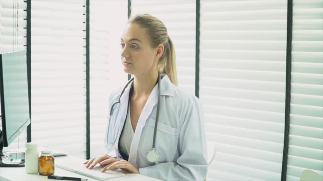Doctor working at laptop in room