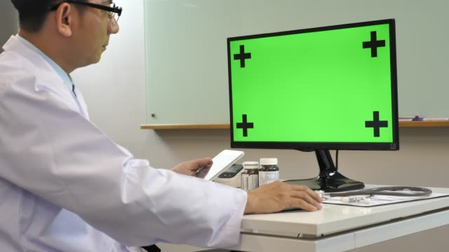 doctor working with computer green screen, chroma key - monitoring equipment stock videos and b-roll footage