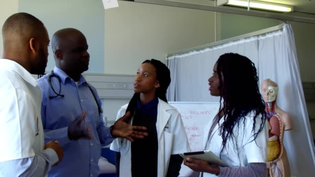doctor working with his medical students - medical student stock videos and b-roll footage