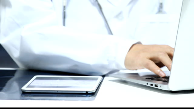 Doctor working with laptop in office