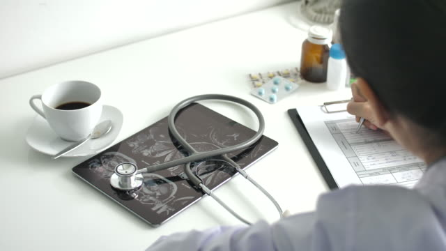 doctor writing on prescription - registration stock videos & royalty-free footage