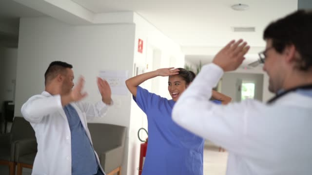 doctors (including special needs boy) and nurse dancing at hospital - winning stock videos & royalty-free footage