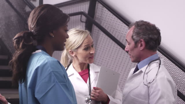 doctors and nurse using tablet - 40 seconds or greater stock-videos und b-roll-filmmaterial