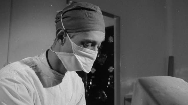1958 montage doctors and nurses at work for the national blood transfusion service / united kingdom - blood bag stock videos and b-roll footage
