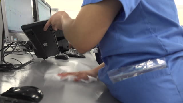 doctors and nurses cleaning down work stations and touch points in imperial college healthcare london resus ward during the coronavirus crisis - cleaning stock videos & royalty-free footage