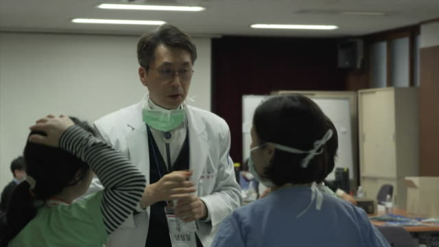 doctors and nurses in crisis centre set up in daegu south korea to help tackle the outbreak of coronavirus - south korea stock videos & royalty-free footage