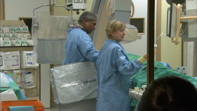 Doctors and nurses in operating room