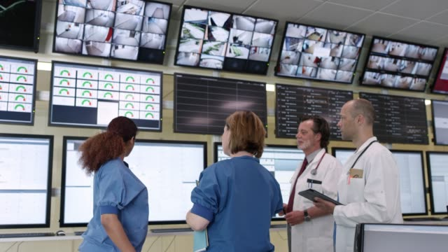 doctors and nurses looking at screens in hospital - protection stock videos & royalty-free footage