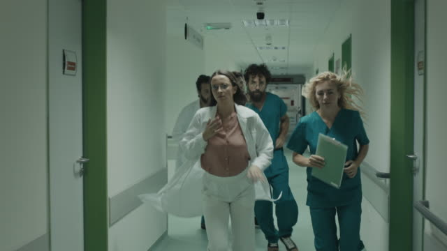 doctors and nurses rushes for emergency in hospital - emergency medicine stock videos & royalty-free footage