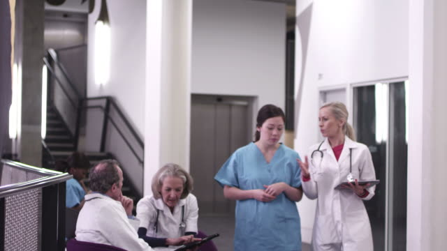 doctors and nurses walking in hospital - 40 seconds or greater stock-videos und b-roll-filmmaterial