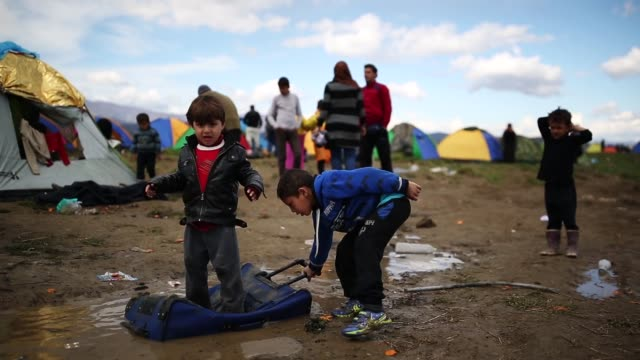 doctors are warning that conditions at the idomeni camp close to the macedonian border are becoming dangerous for children with medics dealing with a... - hypothermia stock videos and b-roll footage