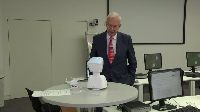 Doctors attend genomics lecture remotely using robots ENGLAND Cambridgeshire Cambridge INT Reporter talking to Neeta Lakhani via the avatar robotic...